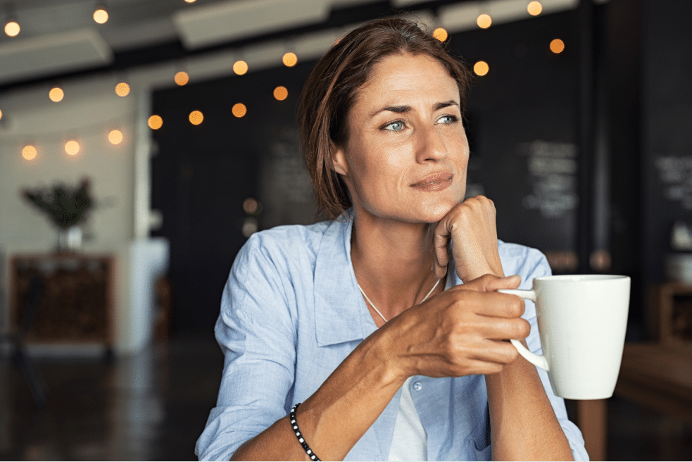 Mature Woman Sipping Coffee